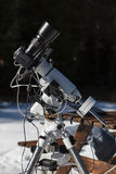 Professional astrophotography setup equipped with DSLR camera, telephoto lens and guider scope Stock Photography