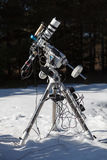 Professional astrophotography telescope equipped with guider scope and astro camera Stock Photography