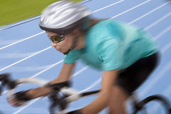 Professional athlete riding race bike on track Stock Photo