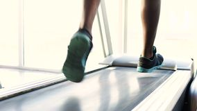 Professional athlete training and running on treadmill before competition. Stock footage stock footage