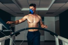 Professional athlete on treadmill monitoring his performance Royalty Free Stock Photography