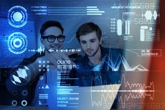 Professioanl programmers working together. Professional attitude. Young programmers coding and working together while providing security Royalty Free Stock Photos