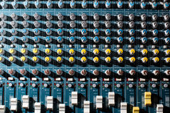 Professional Audio dj mixer console, sound tools and gear, studio equipment picture, selective focus picture of faders. And knobs of mixer Stock Image