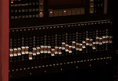Professional Audio Equipment. Console in dark - Equalizer close-up royalty free stock photography