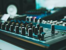 Professional audio equipment with faders knobs and buttons. Macro shot of Professional audio equipment with faders knobs and buttons stock photography