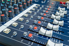 Professional audio mixer. With shallow depth of field stock illustration