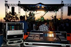 Professional audio mixer desk. Popular local band called Mor ve Otesi performs live at Maltepe open air stage on May 14, 2010 in Istanbul, Turkey Stock Images
