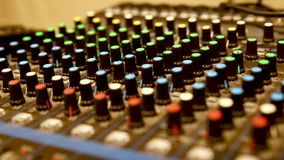 Professional audio mixer. NProfessional audio mixer with many channels, sideways movement n stock footage