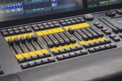 Professional audio mixing console closeup. Music studio Stock Photos