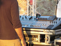 Professional audio mixing console with faders and adjusting knobs for party outdoor at sunset Royalty Free Stock Photos