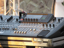 Professional audio mixing console with faders and adjusting knobs for party outdoor at sunset Stock Photo