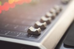 Professional audio mixing console with faders and adjusting knobs - radio. / TV broadcasting royalty free stock image