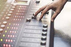 Professional audio mixing console with faders and adjusting knobs - radio. / TV broadcasting stock images