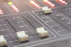Professional audio mixing console with faders and adjusting knobs - radio. / TV broadcasting royalty free stock photos
