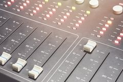 Professional audio mixing console with faders and adjusting knobs - radio. / TV broadcasting royalty free stock photography