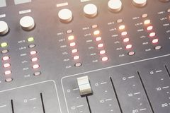 Professional audio mixing console with faders and adjusting knobs - radio. / TV broadcasting royalty free stock photo