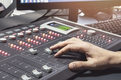 Professional audio mixing console with faders and adjusting knobs - radio. / TV broadcasting stock image