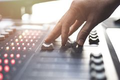 Professional audio mixing console with faders and adjusting knobs - radio. / TV broadcasting royalty free stock images