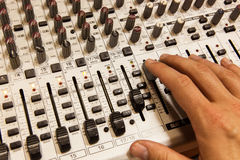 Professional audio mixing console with faders and adjusting knobs Royalty Free Stock Photography