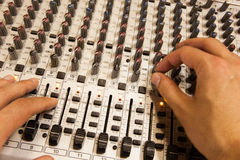 Professional audio mixing console with faders and adjusting knobs Royalty Free Stock Photos