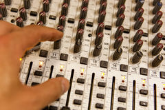 Professional audio mixing console with faders and adjusting knobs Stock Photography