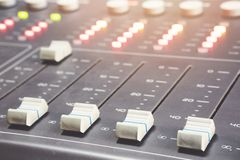 Professional audio mixing console with faders and adjusting knobs - radio. / TV broadcasting stock photo
