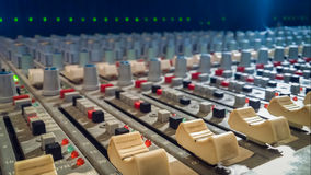Professional audio mixing console with faders in recording studi Stock Images
