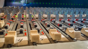 Professional audio mixing console with faders in recording studi Stock Photography