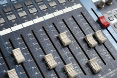 Professional audio mixing console. Recording studio equipment.  Royalty Free Stock Images