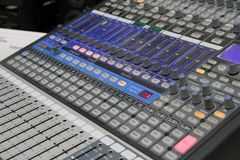 Professional audio operator working on audio mixer knobs during live TV telecast. Professional audio operator working on audio mixer knobs during live radio royalty free stock photo