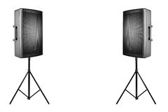 Professional audio speakers PA on the tripods on white. Professional audio speakers PA on the tripods, isolated on white Royalty Free Stock Photo