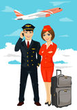 Professional aviation crew members of pilot and stewardess with air plane taking off on background Royalty Free Stock Photo