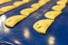 Professional bakery equipment, pastry conveyor Royalty Free Stock Photo