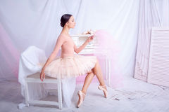 Professional ballet dancer looking in the mirror Stock Images