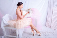 Professional ballet dancer looking in the mirror Royalty Free Stock Photos