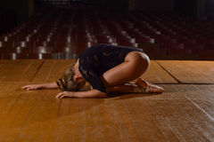 Professional ballet dancer lying on the stage after the performance. Stock Image