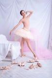 Professional ballet dancer posing on pink Stock Photo