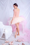 Professional ballet dancer posing on pink Stock Images