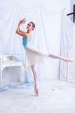 Professional ballet dancer posing on white Stock Photos