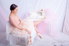 Professional ballet dancer resting after the Royalty Free Stock Image