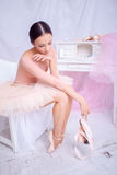 Professional ballet dancer resting after the performance. Stock Photos