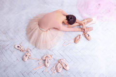 Professional ballet dancer resting after the performance. Royalty Free Stock Image