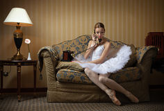 Professional ballet dancer talking on the phone Royalty Free Stock Photos