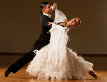 Professional ballroom dance couple preform an exhibition dance Stock Images