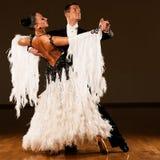 Professional ballroom dance couple preform an exhibition dance. Professional ballroom dance couple preform an romantic exhibition dance Stock Photography