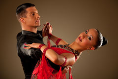 Professional ballroom dance couple preform an exhibition dance Stock Image