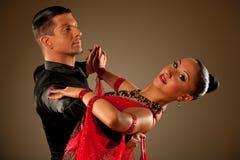 Professional ballroom dance couple preform an exhibition dance. Professional ballroom dance couple preform an romantic exhibition dance Stock Image