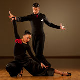 Professional ballroom dance couple preform an exhibition dance Royalty Free Stock Images