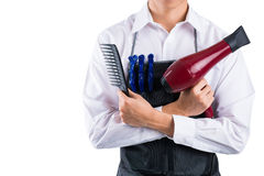 Professional barber. Copy-spaced of a professional barber with necessary equipment in hands isolated on white Royalty Free Stock Photos