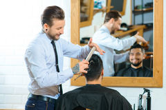 Professional barber making haircut stock photo